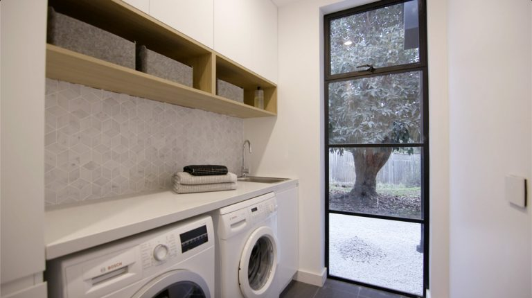 Contemporary laundry in white and light grey